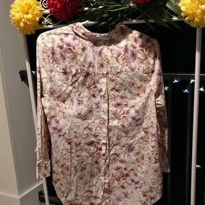 Woman within mauve floral blouse